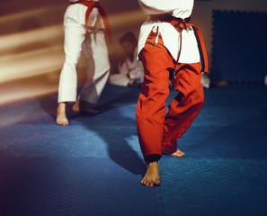 Foto op Aluminium Vechtsport Taekwondo athletes bare feet martial arts movement on floor