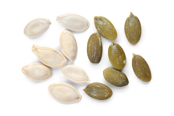 Raw pumpkin seeds on white background, top view