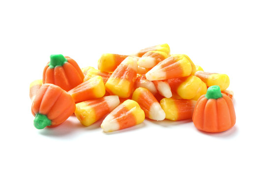 Colorful candy corns for Halloween party on white background