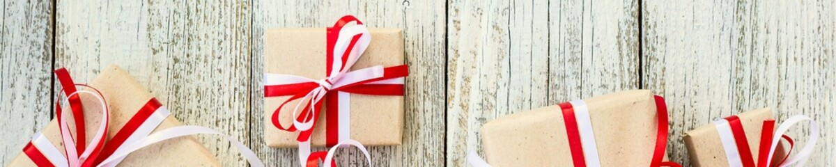 Banner of Presents for any holiday concept. Gift boxes frame, top view with copy space on wood table background