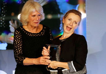Britain's Camilla, the Duchess of Cornwall presents the Man Booker Prize for Fiction 2018 to British writer Anna Burns during the prize's 50th year, at the Guildhall in London