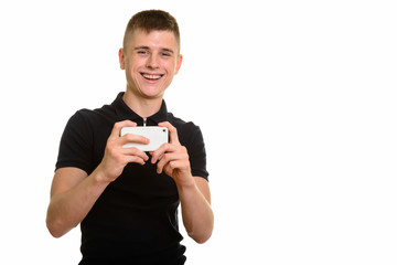 Young happy Caucasian man smiling and taking picture with mobile