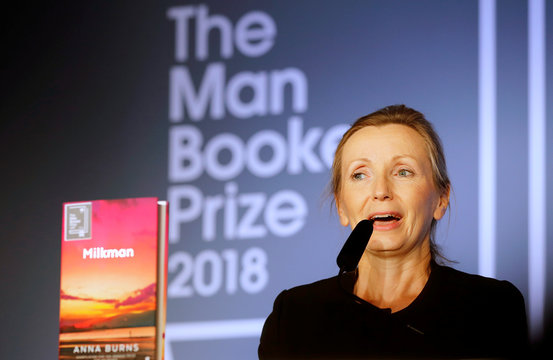 Writer Anna Burns delivers a speech after she was presented with the Man Booker Prize for Fiction 2018 by Britain's Camilla, the Duchess of Cornwall during the prize's 50th year at the Guildhall in London