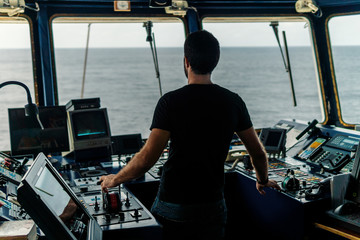 Marine navigational officer is maneuvering ship or vessel during navigation watch. He is using pitch and propulsion