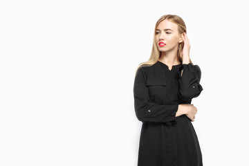 Elegant woman in black dress and with red lips, waiting For black Friday on white background
