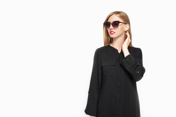 Elegant woman in sunglasses in black dress and with red lips, waiting For black Friday on white background