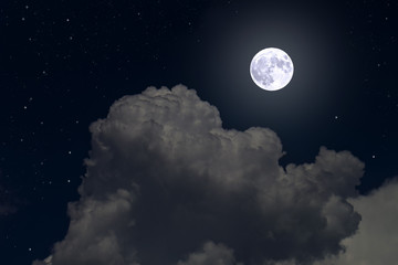 Full moon and stars in cumulus clouds