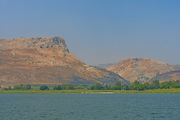 Dramatic Desert Cliffs from a Remote Lake