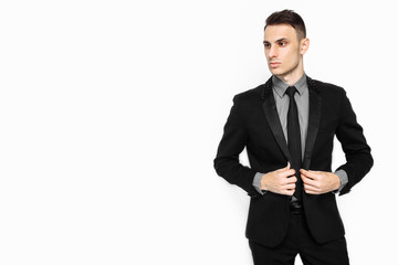 a successful man in a black suit, a businessman posing on a white background