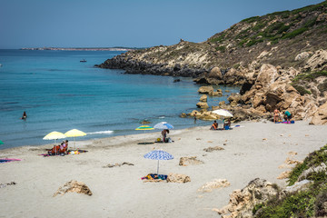 Uncrowded beach scene on a clear sunny day in summer.  Captured in Seu Coast, Oristano province, Sardinia, Italy