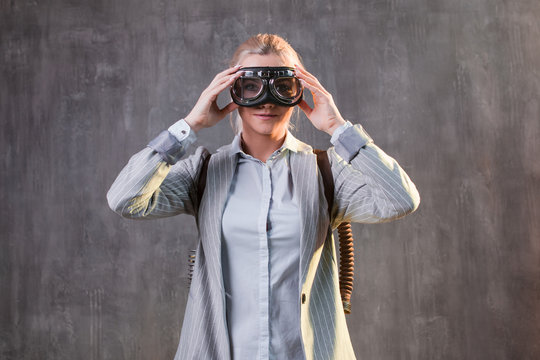 Young woman businesswoman in flight glasses. Concept, business with great success and acceleration
