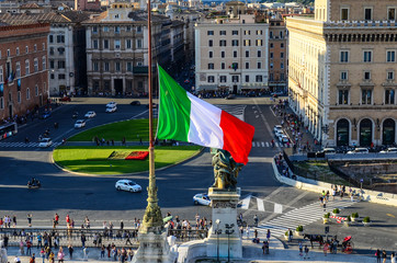 Italian national flag and Piazza Venezia. Vittoriano, Rome, Italy