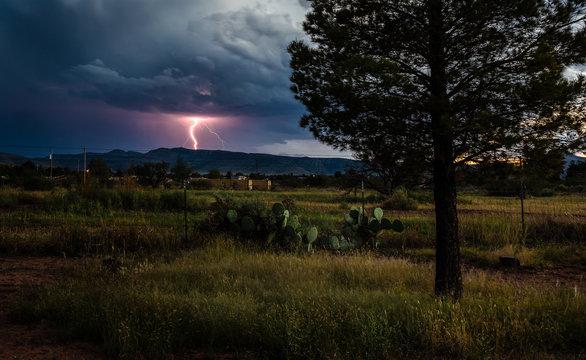 Thunderstorm Near Alpine, Texas At Sunset With Lightening Strike