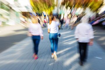 women walking in the pedestrian zone of a city