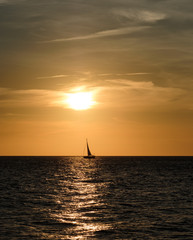 Sailboat silhouette at sunset on Cape May New Jersey