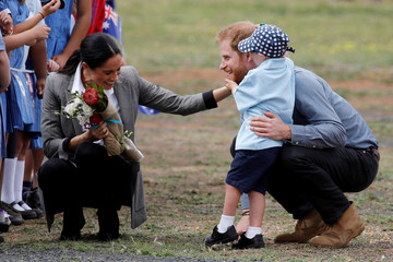 Britain's Prince Harry and Meghan, Duchess of Sussex, interact with Luke Vincent, 5, after arriving at Dubbo airport, Dubbo