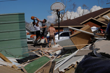 Contractors play a game of basketball against residents in the aftermath of Hurricane Michael in Springfield