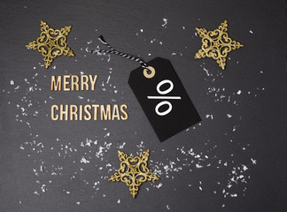 Merry Christmas black background and price label.  Black Friday. Sales concept. Copy space.  Black paper label against a dark grey background. Black Friday shopping sale concept