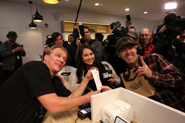 Canopy Growth CEO Bruce Linton poses for a photo with Ian Power and Nikki Rose, who were first in line to purchase the first legal recreational marijuana after midnight, at a Tweed retail store in St John's