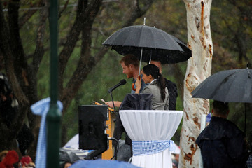 Britain's Prince Harry and his wife Meghan, Duchess of Sussex attend a community picnic at Victoria Park in Dubbo