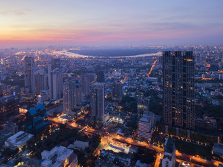 Aerial view of Chong Nonsi, Sathorn, Bangkok Downtown. Financial district and business centers in smart urban city in Asia. Skyscraper and high-rise buildings at night.