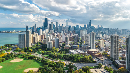 Wall Mural - Chicago skyline aerial drone view from above, lake Michigan and city of Chicago downtown skyscrapers cityscape from Lincoln park, Illinois, USA