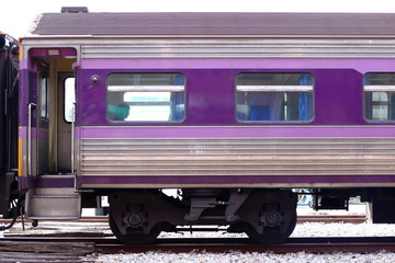 Cropped image of purple bogie of  train on railway.