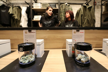 A customer looks at cannabis on display after legal recreational marijuana went on sale at a Tweed retail store in St John's