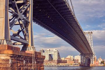 Vintage toned picture of Manhattan Bridge at sunset, New York City, USA.