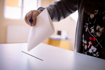 Person voting, casting a ballot