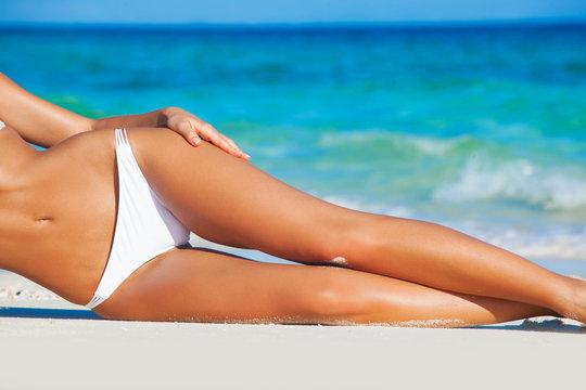Tanned woman in bikini