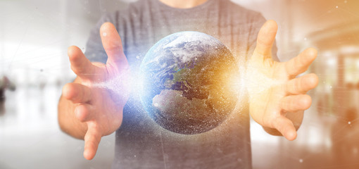 Man holding a 3d rendering particles earth globe