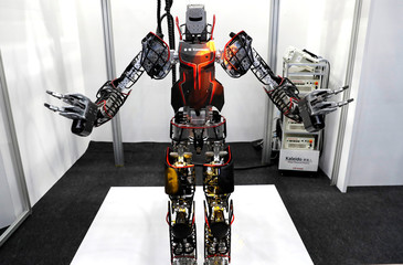 Kawasaki's Robust Humanoid Platform Kaleido performs a dance along with music during its demonstration at World Robot Summit in Tokyo