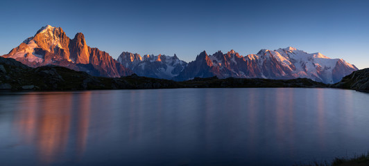 Panorama of the Alps near Chamonix, with Aiguille Verte,  Auguille du Midi and Mont Blanc, during sunset at Lac des Cheserys. Chamonix, France.