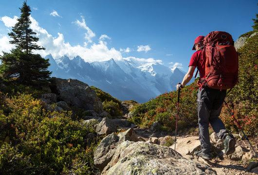 A man hiking on the famous Tour du Mont Blanc near Chamonix, France.