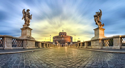Panoramic low angle view of Sant'Angelo bridge and castle on sunrise in Rome, Italy (HDR image)