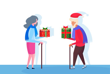 senior couple with stick giving each other gift box happy new year merry christmas concept female male cartoon character profile full length isolated vector illustration