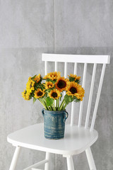 Wall Mural - Bouquet of sunflowers on grey stone background