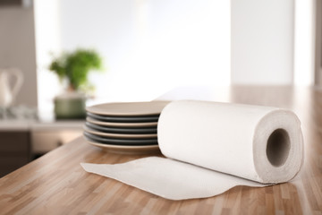Roll of paper towels with plates on kitchen table
