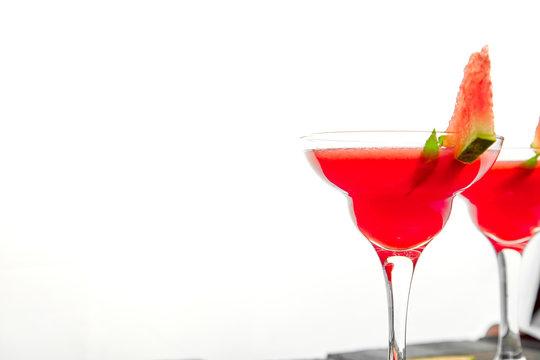 Watermelon margarita cocktail on white background. Fresh watermelon lemonade