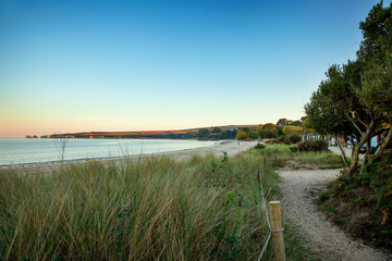 View over the beach and Old Harry Rocks at South beach, Studland, Dorset. Taken at dusk