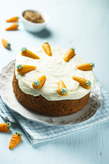 Homemade carrot cake with marzipan carrots