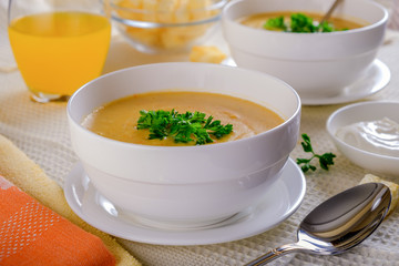 Still life with lentil cream soup in a white cup