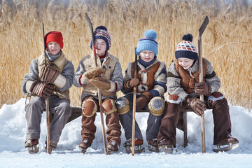 Group of boys are bench for hockey