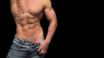 Muscular shirtless male torso isolated on black