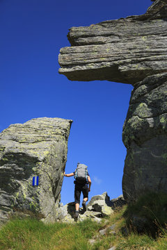 Hiker on the famous Via Alta Verzasca in the Ticino mountains. Switzerland.