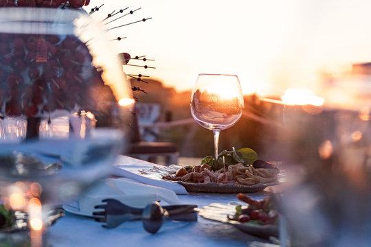 Couple enjoying wine against a beautiful sunset.