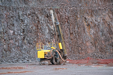 Driller in a Porphyry mine quarry.