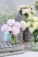Bouquet of pink peonies and other plants in flower shop.