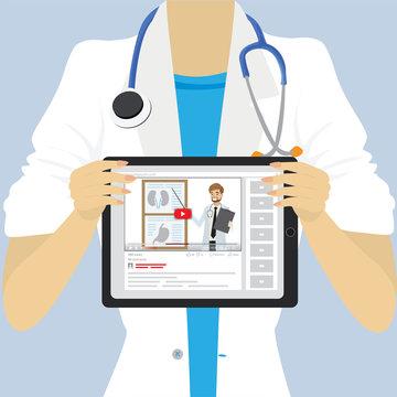 Female doctor or nurse holding medical tablet pc